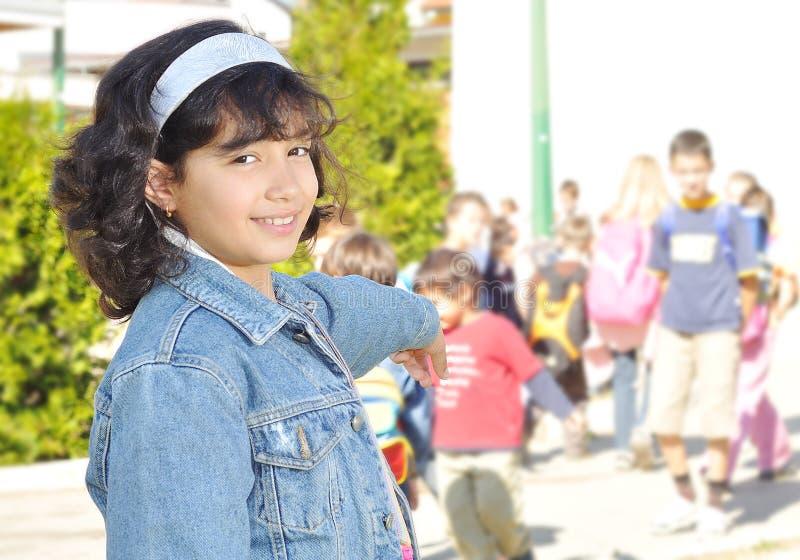 Crianças felizes na frente da escola fotografia de stock royalty free