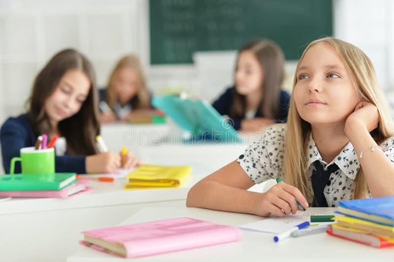 Crianças na escola nas lições fotografia de stock royalty free