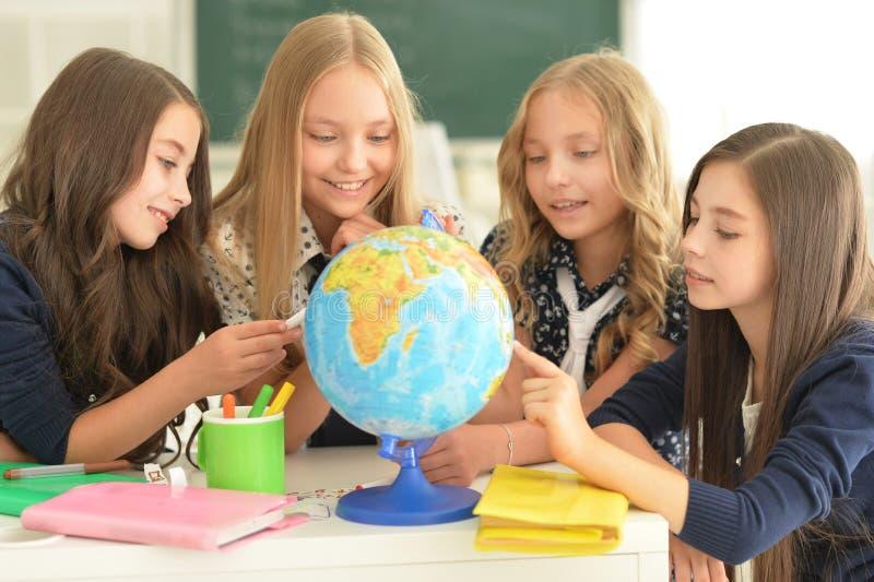 Crianças na escola nas lições foto de stock royalty free