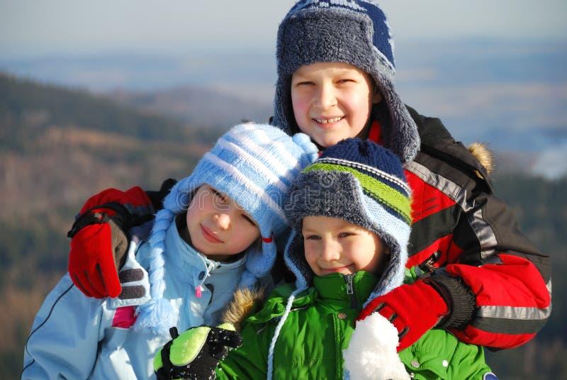 Crianças no inverno. fotografia de stock royalty free