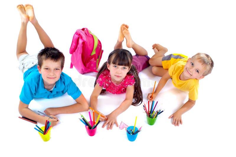 Crianças que desenham junto fotos de stock royalty free