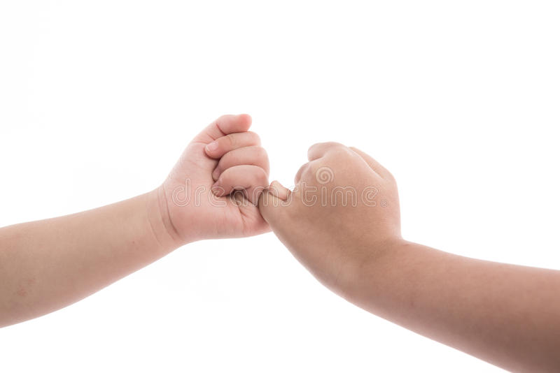 Crianças que fazem promis de um dedo mínimo fotos de stock
