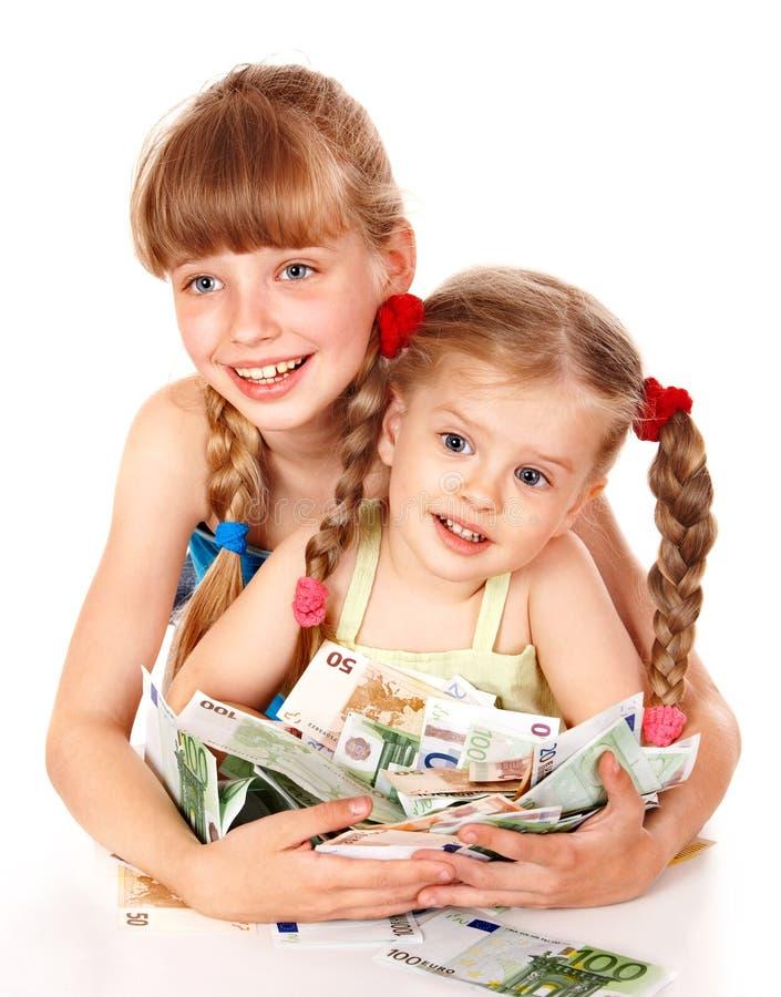 Crianças que prendem a pilha de dinheiro. fotografia de stock royalty free