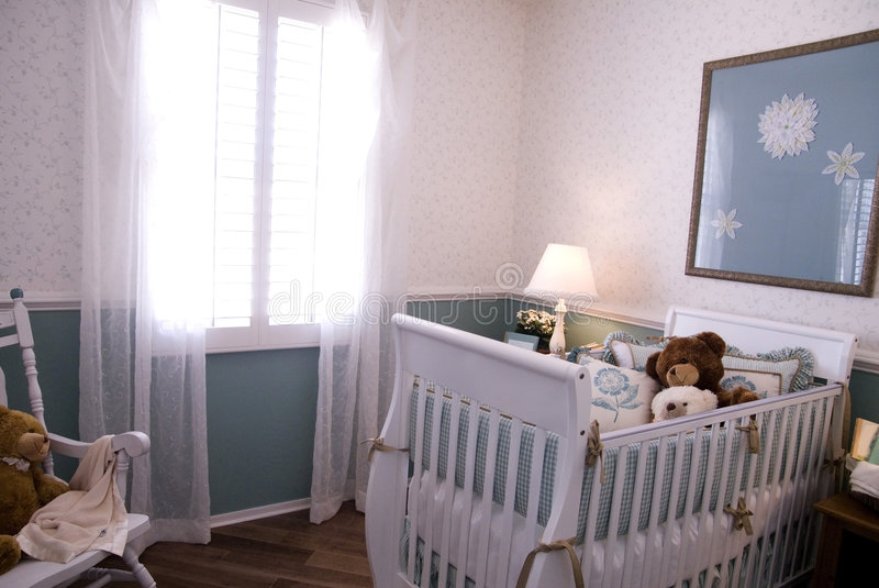 A crib in a baby room interior stock photography