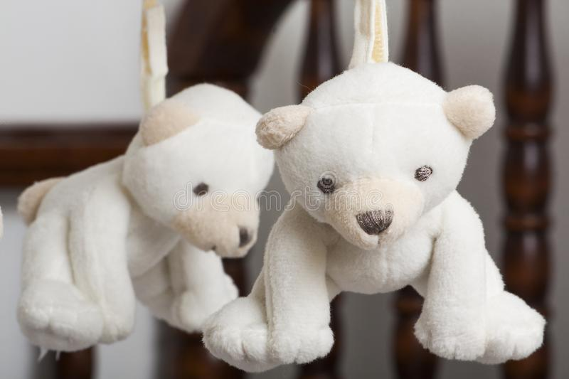 Crib and bears. Bears are hanging to help a young child relax in their crib royalty free stock photo