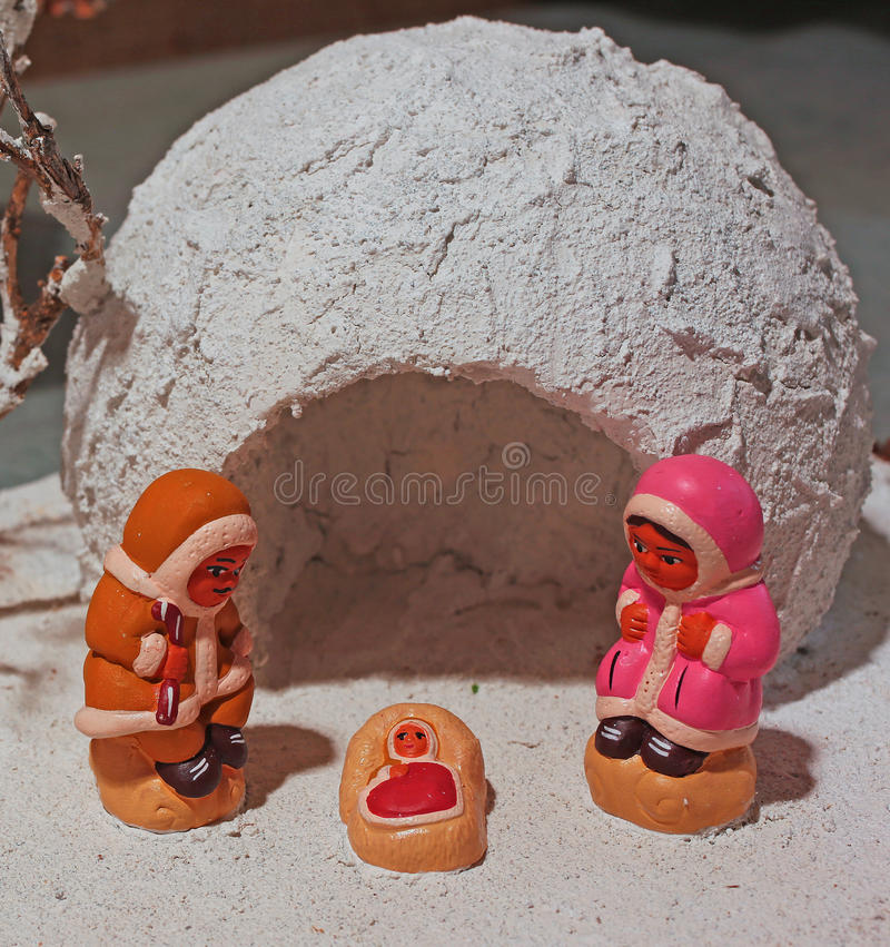 Crib with the Eskimos to the north pole and a white ice igloo. Ethnic crib with the Eskimos to the north pole and a white ice igloo royalty free stock image