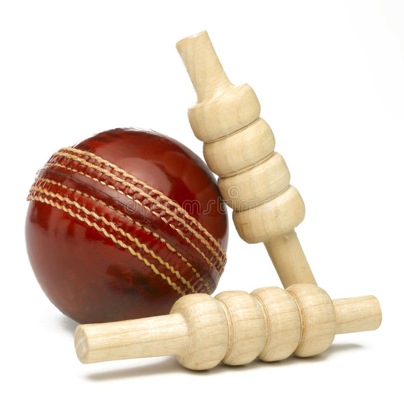 Cricket Ball. And bailes isolated on white royalty free stock photos