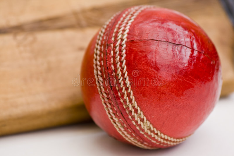Cricket ball and bat. Close up of cricket ball and cricket bat stock photography