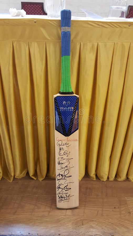Cricket bat autographed by cricket legends. Sports professional cricket bat memorabilia of a player signed by world`s best cricket players to be auction for stock image