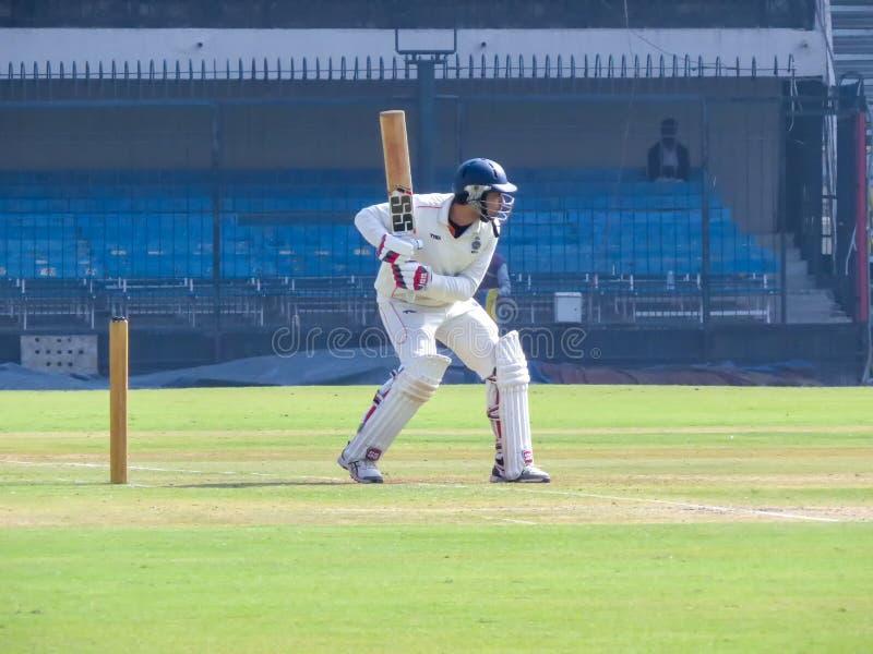Cricket Batsman Playing Shot, Close-up photo. royalty free stock image
