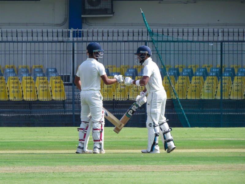 Cricket Batsman Punching Gloves. royalty free stock photography