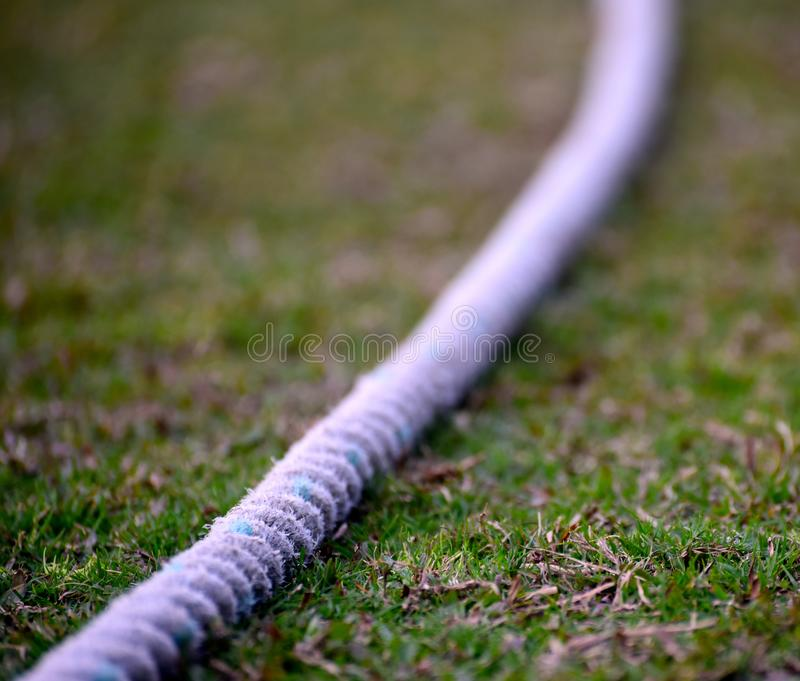 Cricket boundary rope isolated object photograph. The white cricket boundary rope isolated object stock photograph captured from a cricket ground royalty free stock photo