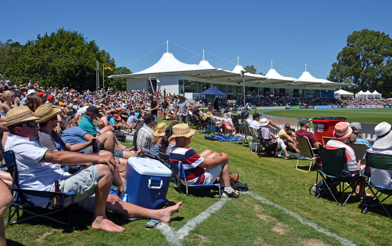 Cricket - Boxing Day Test Match Crowd at Hagley Oval Christchurch. Christchurch, New Zealand - December 26, 2014: Spectators sitting on the bank watching the royalty free stock photos