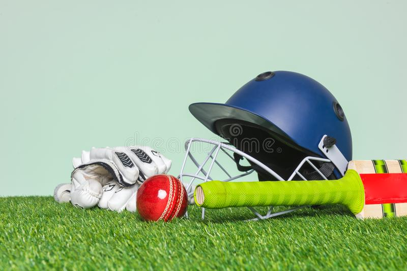 Cricket equipment on grass royalty free stock image