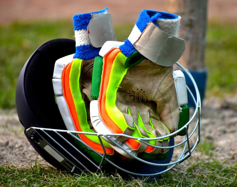 Cricket Gears Helmet and Batting Gloves Background Photograph stock photos
