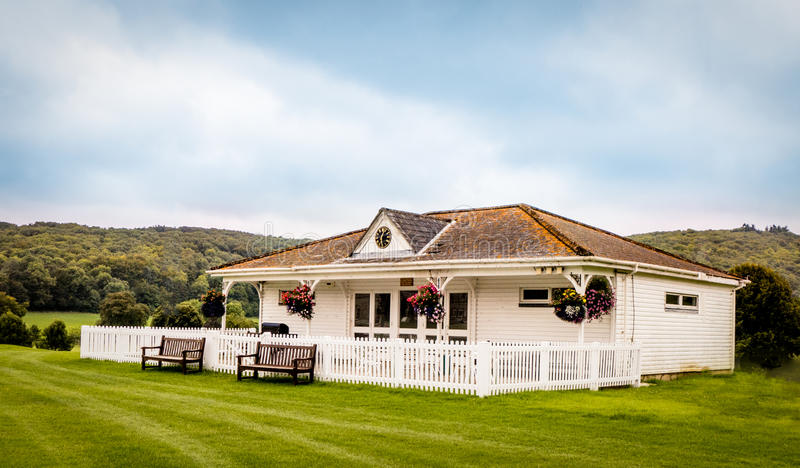 Cricket Pavilion. Situated by a school cricket ground with benches at the front for reserve players stock photos