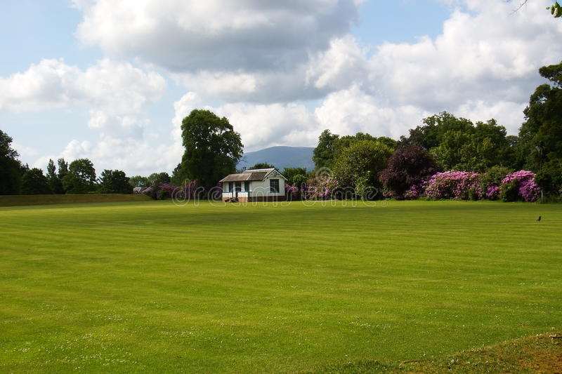 Cricket Pavilion. A sports field and cricket green and pavilion club house stock photography