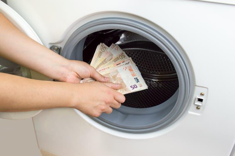 Crime da lavanderia do dinheiro fotos de stock