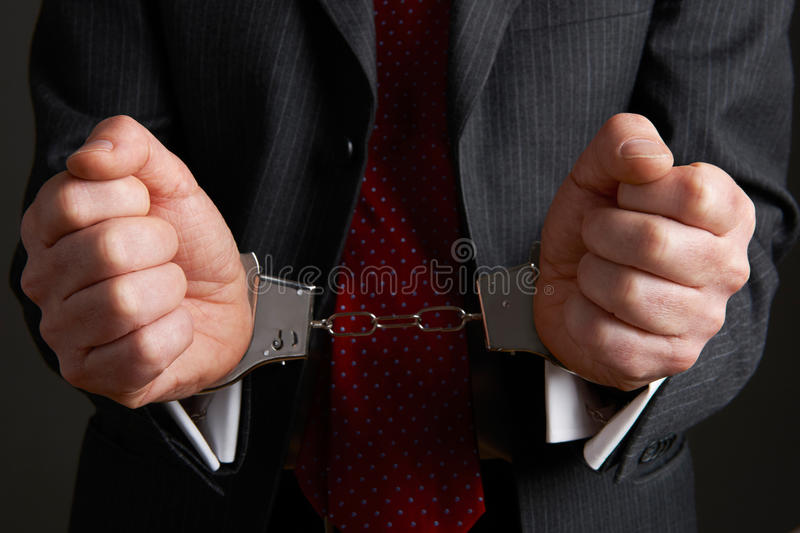 Crime incorporado de Wearing Handcuffs Illustrating do homem de negócios fotografia de stock royalty free