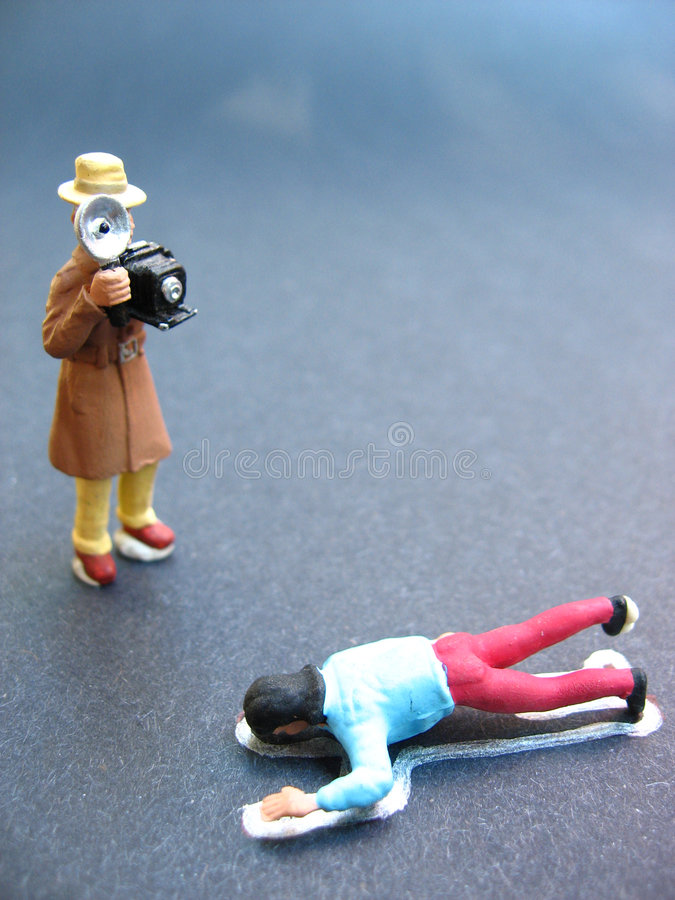 Crime scene. A crime scene photographer taking picture of dead body royalty free stock image