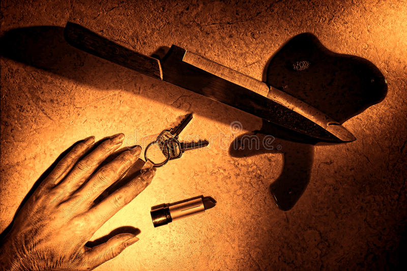 Crime Scene with Dead Woman Hand and Bloody Knife royalty free stock images