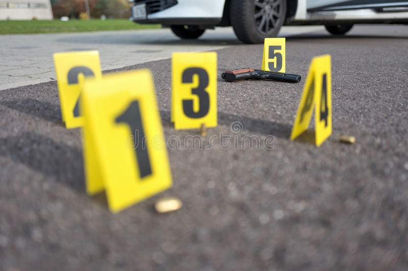 Crime scene after gunfight. ID tents at crime scene after gunfight stock photography