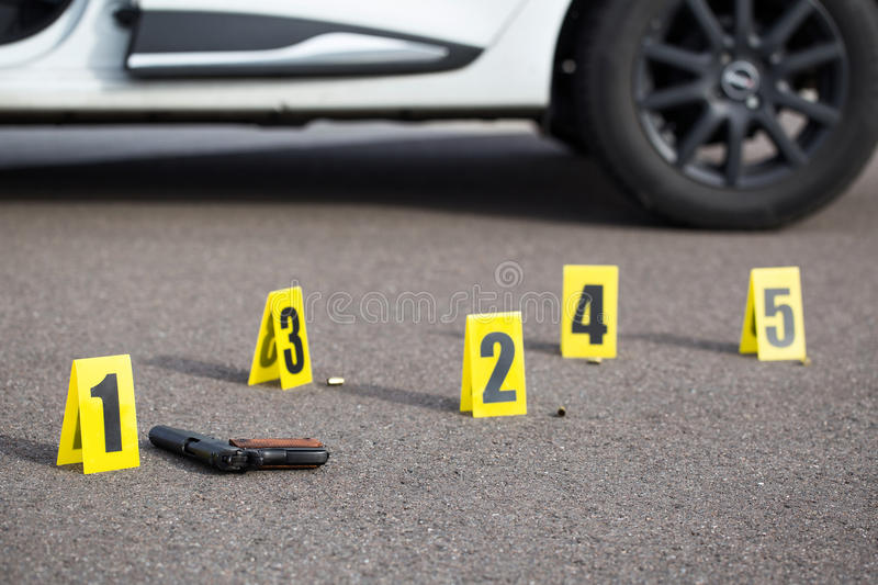 Crime scene after gunfight. ID tents at crime scene after gunfight stock photo