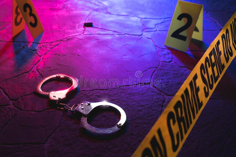Crime scene handcuffs on the floor at night stock photos