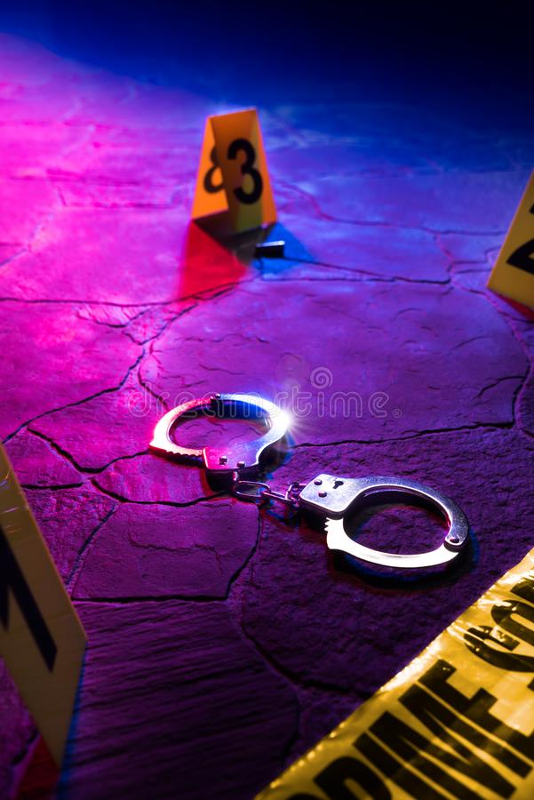 Crime scene handcuffs on the floor at night stock photography