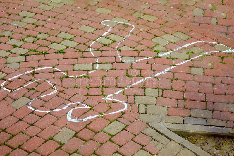 Crime scene with human body outline by chalk,drawing on the pavement. Outdoors, copy space stock photo
