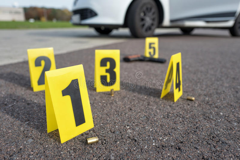 Crime scene. ID tents at crime scene after gunfight stock images
