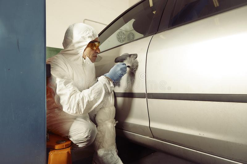 Police team working on traces collecting on confiscated car stock image