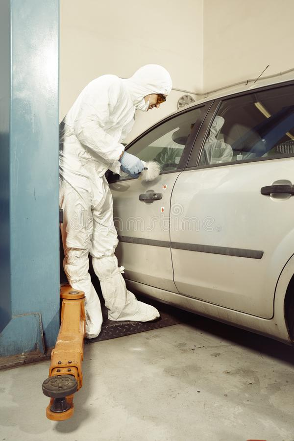 Police team working on traces collecting on confiscated car royalty free stock photos