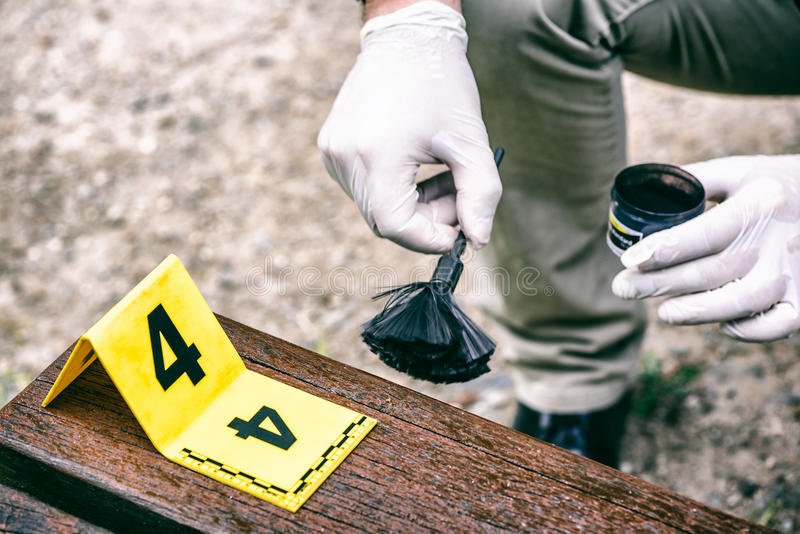 Crime scene investigation. Using of dactyloscopic brush to reveal fingerprints royalty free stock photo
