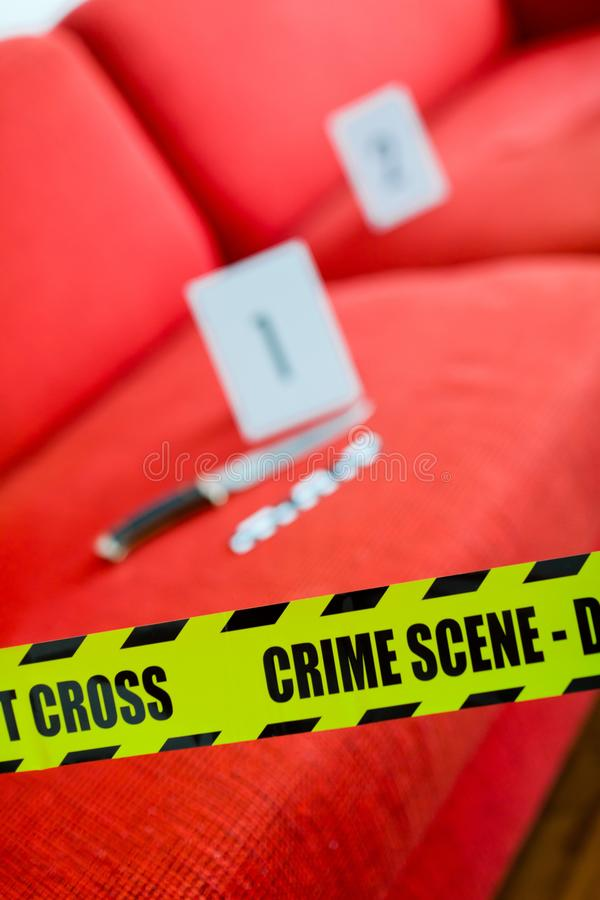 Crime scene with knife and yellow gap stock image