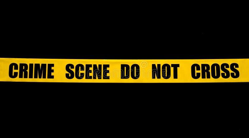 Crime scene police tape. On black background royalty free stock photo