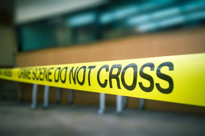 Crime scene tape of mysterious case in cenematic tone with copy stock photography