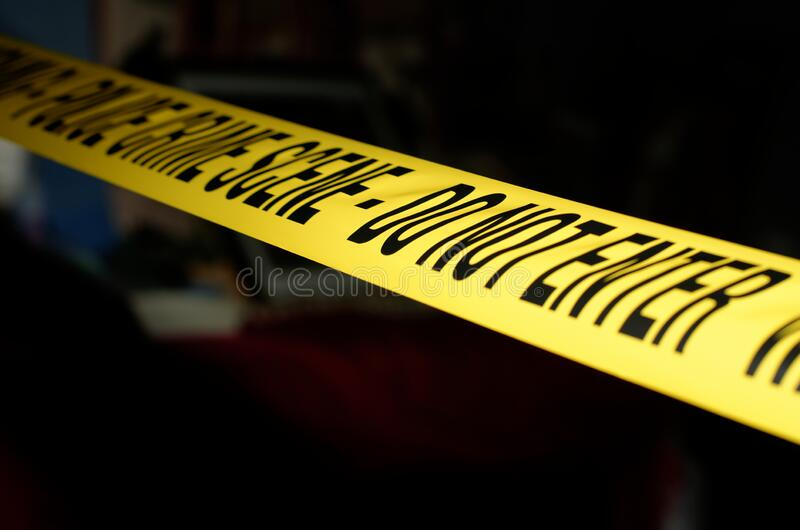 Crime Scene tape. Yellow Police Crime Scene tape across a staged crime scene royalty free stock image