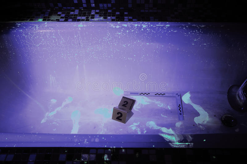 Crime scene under UV light. Developing of evidence on place of bloody crime stock photography