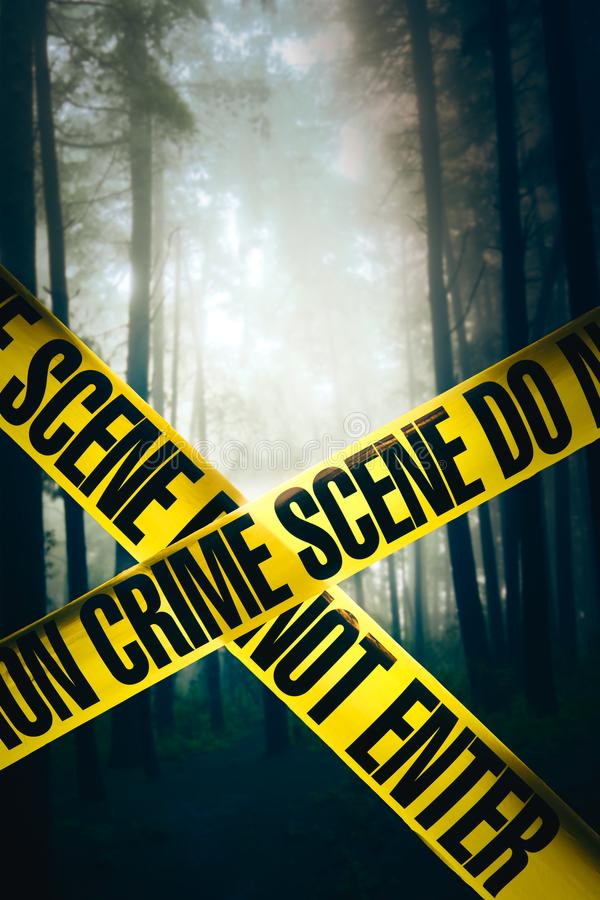Crime scene in the woods. Crime scene tape in the woods royalty free stock photos