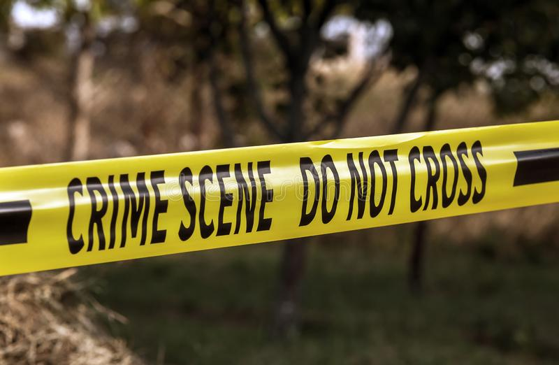 Crime scene yellow police tape closeup royalty free stock photo