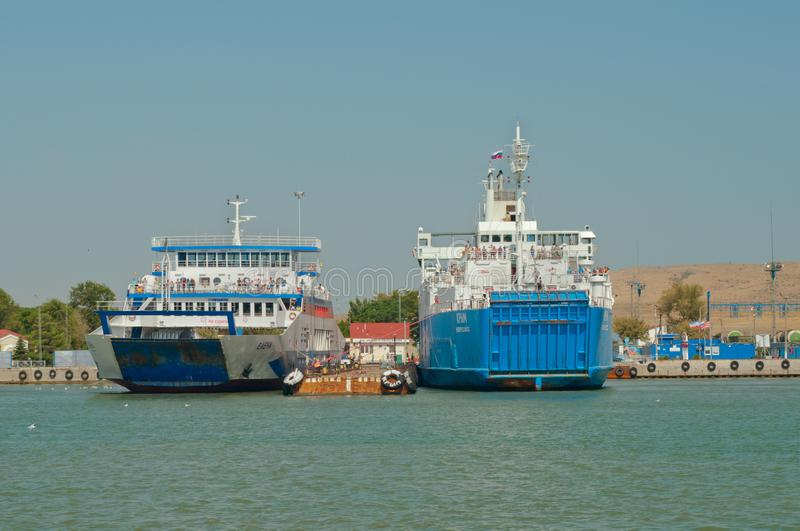 Crimea, August 2017. Ferries `Elena` and `Crimea` are preparing to depart from the pier `Port of Crimea`. Editorial use only. Ferries come to the `Port of Crimea stock photo