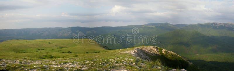 Crimea plateau Chatyr-Dag in the spring green view of mountains. Crimea plateau Chatyr-Dag green spring panorama of the mountains of the Peninsula stock photos