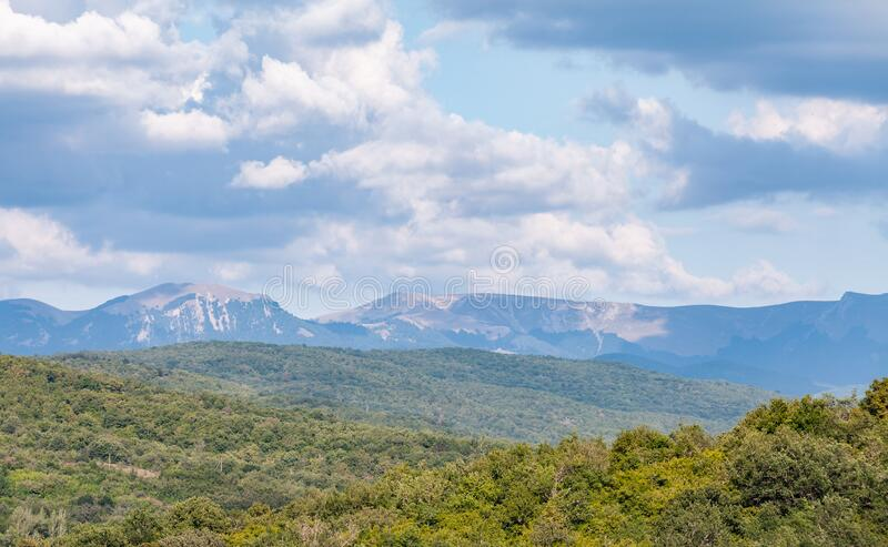 Crimean mountains at sunny summer day. Under cloudy sky, rural summer landscape photo background royalty free stock photography