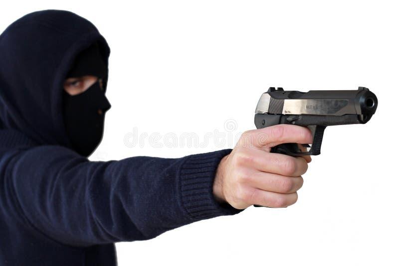 Criminal aislado con el arma fotografía de archivo libre de regalías