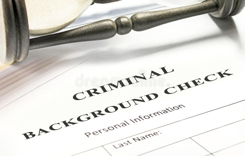 Criminal background check. Application form with hourglass on background royalty free stock images