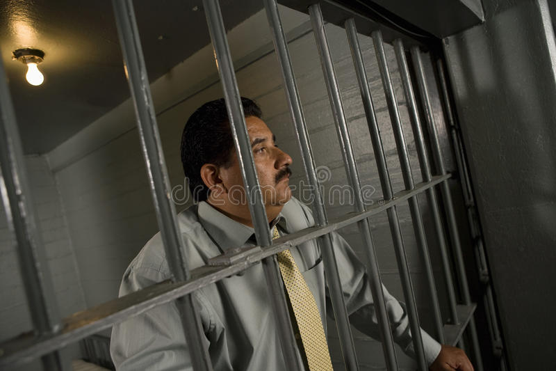 Criminal Behind Bars In Jail royalty free stock images