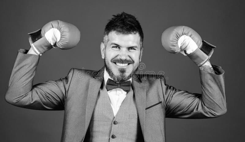 Criminal defense lawyer planning out strategies. Businessman wear boxing gloves. Best criminal defense lawyer strategies. Attack and defense concept stock photos