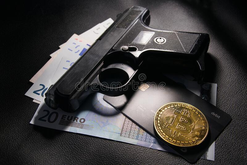criminal Euro money and gun in the light.