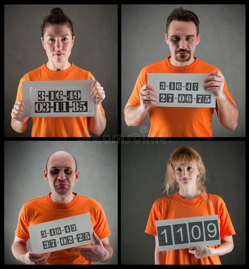 Criminal gang. Arrested criminal gang wearing orange jumpsuit stock image